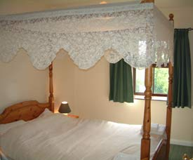 Hayloft Cottage has a four-poster bed